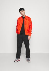 Alpha Industries - Bomber Jacket - atomic red - 1