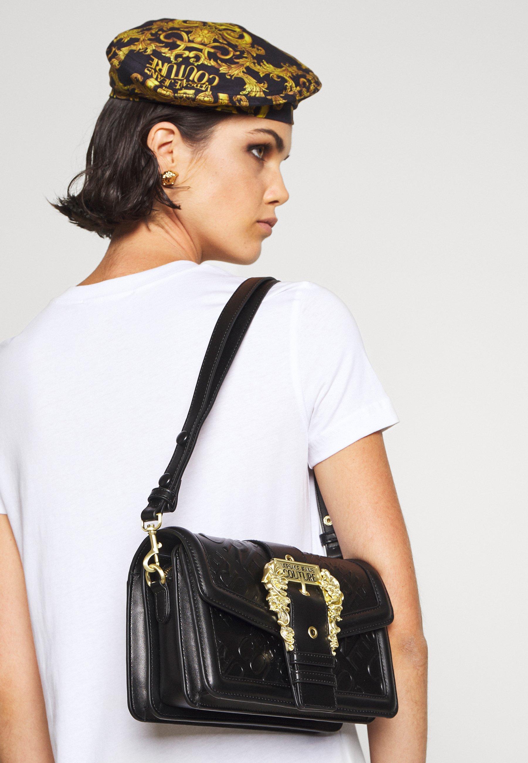 Women DEBOSSED MONOGRAM SHOULDER BAG - Handbag