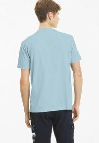 Puma - REBEL BOLD  - T-shirt imprimé - aquamarine - 2