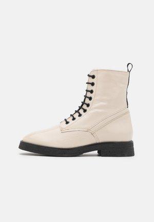 MELA  - Lace-up ankle boots - chalk