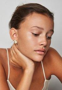 Polar Jewelry - Single earring Thumbelina - Right - Orecchini - gold - 0