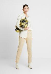 Gina Tricot - VICKY TROUSERS - Trousers - irish cream - 1