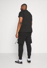 Urban Classics - TACTICAL PANTS - Tracksuit bottoms - black - 2