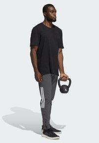 adidas Performance - CITY ELEVATED T-SHIRT - Basic T-shirt - black - 1