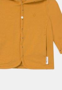 Noppies - BABY REVERSIBLE BONNY UNISEX - Vest - honey yellow - 3
