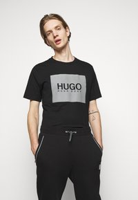 HUGO - DOX  - Tracksuit bottoms - black - 3
