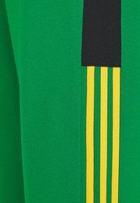 adidas Originals - CLASSICS  - Tracksuit bottoms - green/black - 5