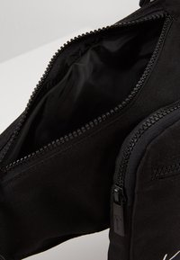 Karl Kani - SIGNATURE TAPE BODY BAG - Bum bag - black/white - 4