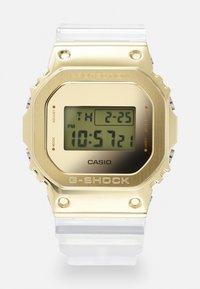 G-SHOCK - GOLD-INGOT TRANSPARENT GM-5600SG UNISEX - Digital watch - gold-coloured /transparent - 0