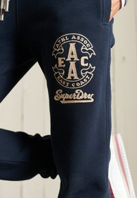 Superdry - COLLEGIATE  - Tracksuit bottoms - eclipse navy - 3