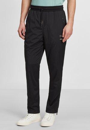 Pantaloni sportivi - black / leopard