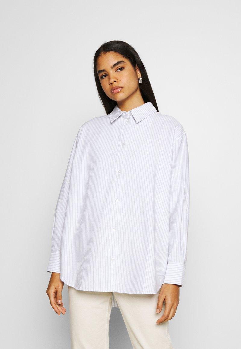 Weekday - EDYN OXFORD - Button-down blouse - blue/white