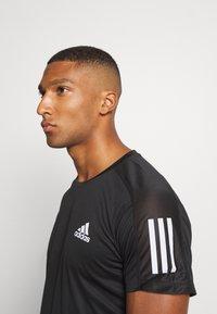 adidas Performance - RESPONSE RUNNING SHORT SLEEVE TEE - T-shirt z nadrukiem - black - 3