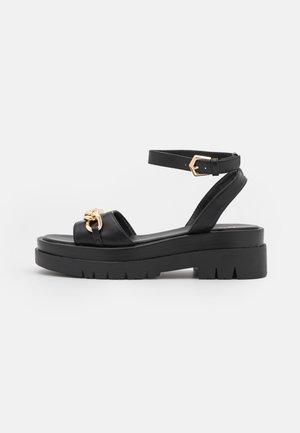 ELISE - Korkeakorkoiset sandaalit - black
