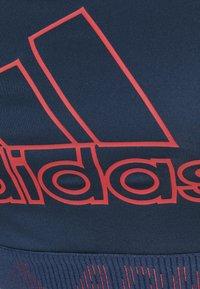 adidas Performance - Reggiseno sportivo con sostegno medio - navy/blue - 2