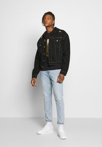 Versace Jeans Couture - T-shirts print - black - 1