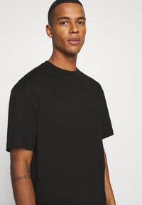 Weekday - OVERSIZED - T-shirt basic - black - 4