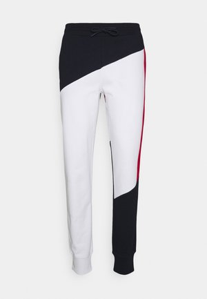 BLOCKED TERRY CUFFED PANT - Pantalon de survêtement - blue/white/red