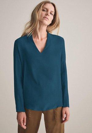 Blouse - mottled light blue