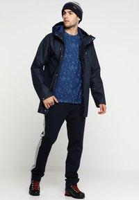 Helly Hansen - MOSS RAIN COAT - Waterproof jacket - navy - 1