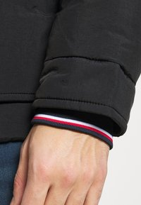 Tommy Hilfiger - Down jacket - black - 5