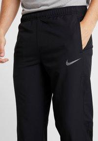 Nike Performance - DRY PANT TEAM - Tracksuit bottoms - black/hematite - 4