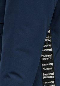 Hummel - URBAN JACKET  - Winter coat - black iris - 6