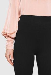 Even&Odd - FLARED LEG LEGGINGS - Leggings - Trousers - black - 6