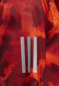 adidas Performance - OWN THE RUN CAMOUFLAGE JACKET - Softshelljacka - orange - 3