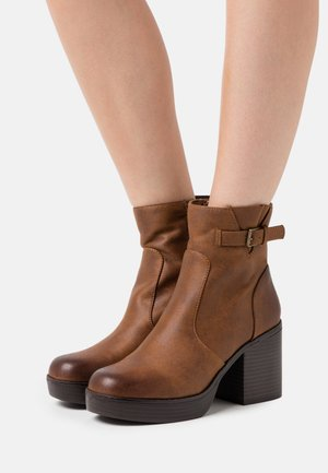 NEWSESENTA - Platform ankle boots - karma