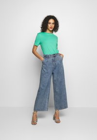 Monki - NANI TROUSERS - Široké džíny - blue medium dusty - 1