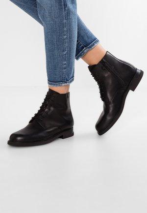 IMAN - Bottines à lacets - black
