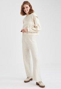 DeFacto - Trousers - beige - 1