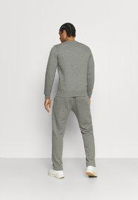 Champion - STRAIGHT HEM PANTS - Tracksuit bottoms - grey - 2