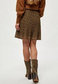 Minus - RIKKA - A-line skirt - dark olive dot print - 2