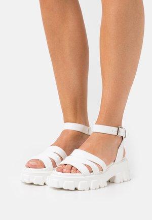 HARMONIE - Platform sandals - white