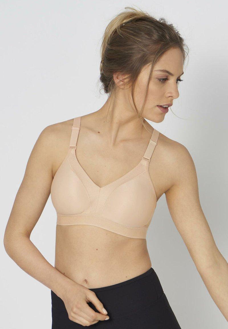 triaction by Triumph - WELLNESS  - Medium support sports bra - neutral beige