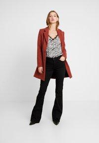 Ivy Copenhagen - CHARLOTTE SERIOUSLY - Flared Jeans - black - 1