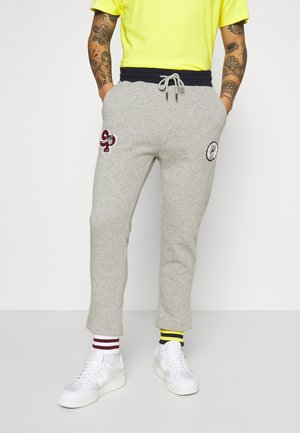 UNISEX TEAMWORK - Tracksuit bottoms - heather grey