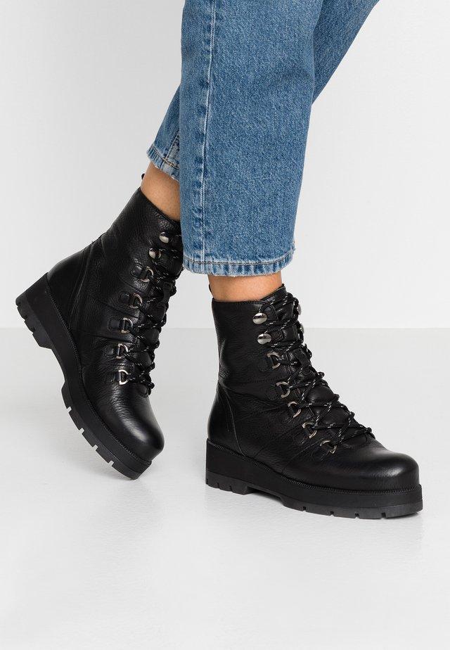 FRODO - Platform ankle boots - black