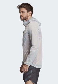 adidas Performance - TERREX AGRAVIC RAIN JACKET - Sports jacket - white - 3