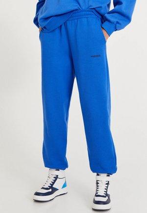 MIT BUNTEM SLOGAN - Pantaloni sportivi - blue
