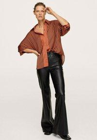 Mango - OVERSIZE À RAYURES - Button-down blouse - marron - 1