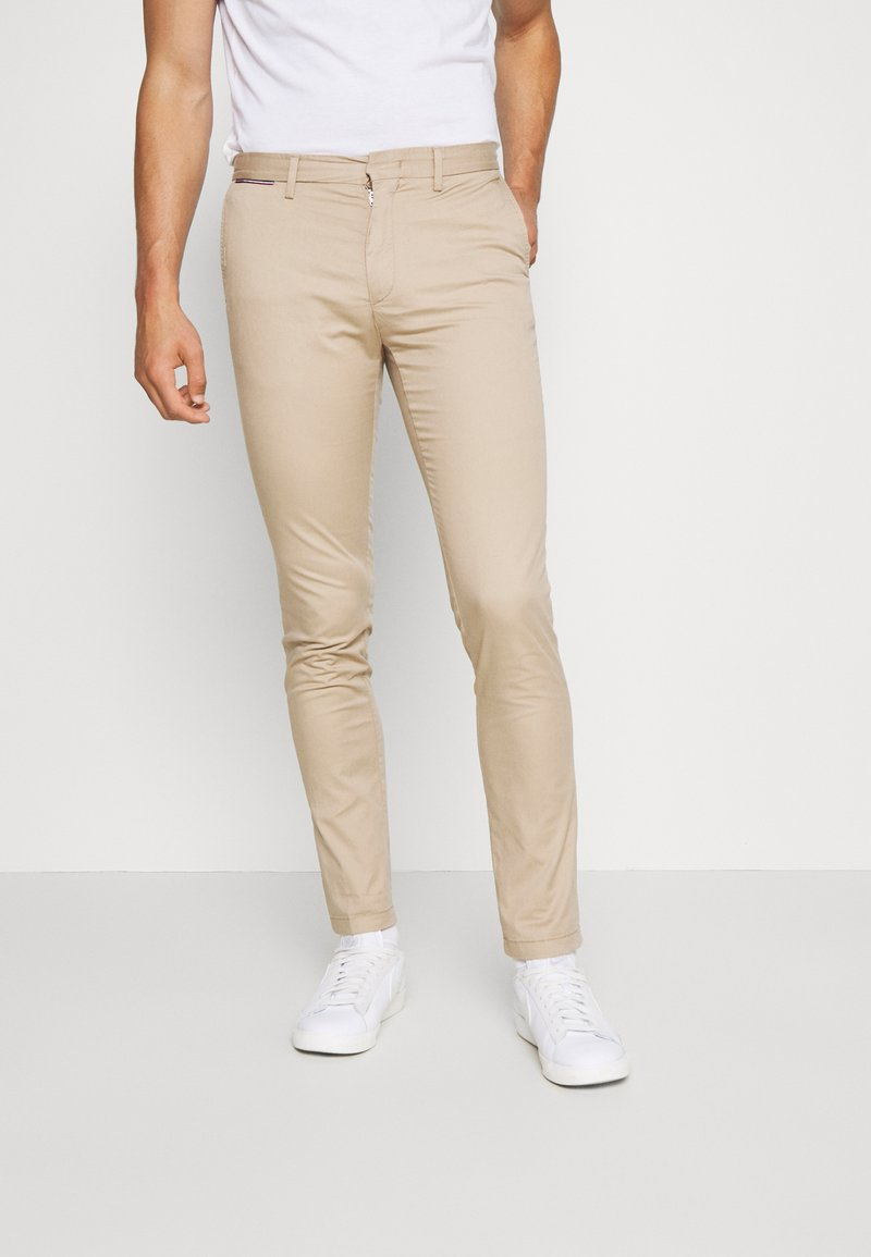 Tommy Hilfiger - BLEECKER FLEX SOFT  - Trousers - beige