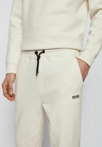 BOSS - Tracksuit bottoms - natural - 3