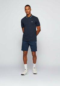 BOSS - PADDY PIXEL - Polo shirt - dark blue - 1