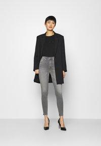 Calvin Klein Jeans - SHINY CROP TEE - Long sleeved top - black - 1