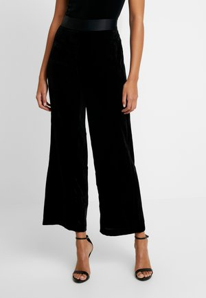 THE PANTS - Trousers - black