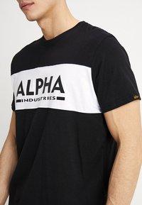 Alpha Industries - Print T-shirt - black - 4