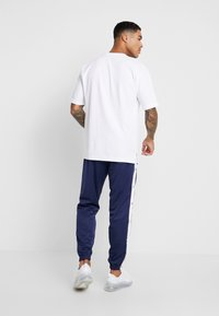 Nike Sportswear - TEARAWAY  - Pantalon de survêtement - midnight navy/white - 2